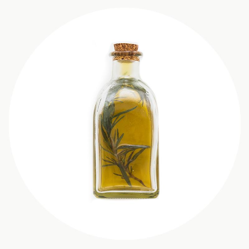 Aceite Ecológico con una rama de olivo natural