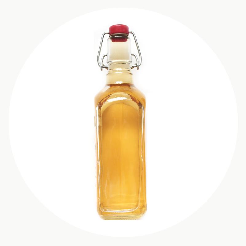 Vinagre ecológico con un envase hermético de vidrio